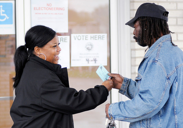 Don Knight | The Herald Bulletin<br /> Anderson school board candidate Tammy Sloss talks to voters outside the polls at the Anderson Zion Baptist Church on Tuesday.