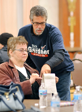 John P. Cleary |  The Herald Bulletin<br /> Republican candidate for Madison County Auditor Rick Gardner, right, checks numbers with supporter Judy Doucette at the Republican 2016 Election Celebration at the Paramount Ballroom Tuesday evening.