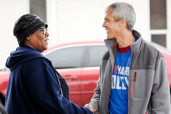 Don Knight | The Herald Bulletin<br /> Judge Mark Dudley talks to voters outside the polls at the Anderson Zion Baptist Church on Tuesday November 8th.