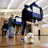 John P. Cleary |  The Herald Bulletin<br /> Christy Ragsdale casts her vote at Union 3 as her dog Lenny chills at her feet waiting for the walk home from Mill Creek Civic Center in Chesterfield.
