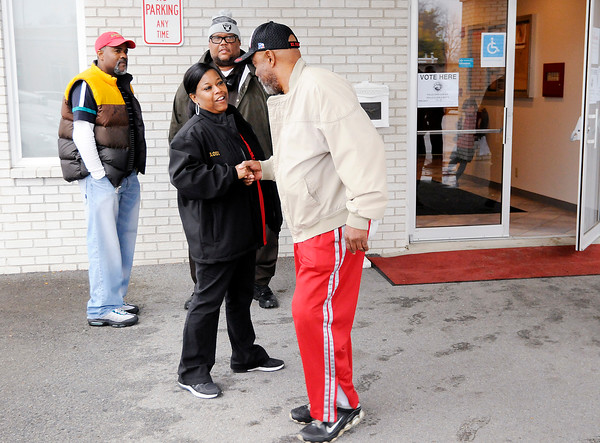 Don Knight | The Herald Bulletin<br /> Anderson school board candidate Tammy Sloss talks to voters at the polls on Tuesday.