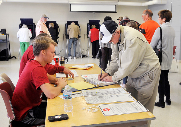 John P. Cleary |  The Herald Bulletin<br /> The voting machines were full with people waiting as more checked in to vote at Ward 1, Precinct 7 at the National Guard Armory Tuesday morning.