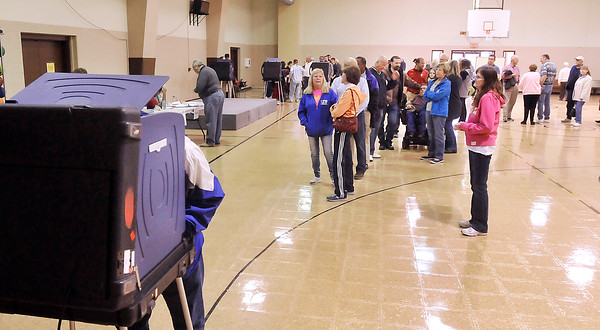 John P. Cleary |  The Herald Bulletin<br /> Union 2 voters at Bethay Christian Church wait in a long line for the next open voting machine Tuesday morning as large numbers turned out to vote.