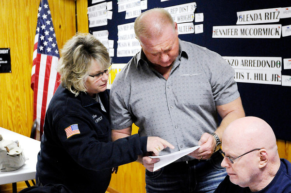 Don Knight | The Herald Bulletin<br /> County Council democratic incumbent Lisa Hobbs looks over election results with Dave Cravens at Democratic Headquarters on Tuesday.