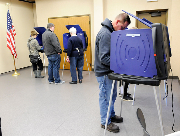 Don Knight | The Herald Bulletin<br /> Voters cast their ballot at the Pendleton Library on Tuesday. There was a line of voters most of the day and poll workers reported an almost 80 percent turnout at 5 p.m.