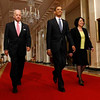 President Barack Obama smiles as he and Vice President Joe Biden escort his Supreme Court choice Sonia Sotomayor, right, before the announcement, Tuesday, May 26, 2009, in the East Room of the White House in Washington.