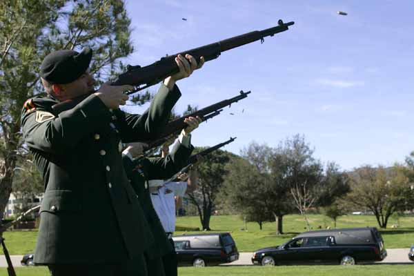 Members of VFW District Seven shoot during a gun salute at a memorial service for five homeless veterans at Pierce Brothers Valley Oaks Memorial Park in Westlake Village, Tuesday, March 16, 2010.<br /> Glenn Davis, Jefferson Robinson, Sanford L. Garland and Paul Deighton who served in the U.S. Army and Valentine Plaska who served as a Merchant Marine were honored with military funeral honors. Their interment will take place at Riverside National Cemetery on Wednesday.<br /> (Michael Owen Baker/Staff Photographer)