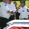 VFW members Al Lansdale, center, and Ty Wilcox, right, present a folded flag to Wayne Wright during a memorial service for five homeless veterans at Pierce Brothers Valley Oaks Memorial Park in Westlake Village, Tuesday, March 16, 2010.<br /> Glenn Davis, Jefferson Robinson, Sanford L. Garland and Paul Deighton who served in the U.S. Army and Valentine Plaska who served as a Merchant Marine were honored with military funeral honors. Their interment will take place at Riverside National Cemetery on Wednesday.<br /> (Michael Owen Baker/Staff Photographer)