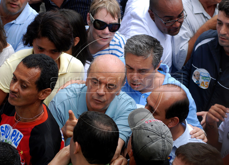 Brazil's presidential candidate Jose Serra, center, of the opposition PSDB party, attends a campaign rally in Copacabana beach, Rio de Janeiro, Brazil, October 24, 2010. Serra will face Dilma Rousseff of the ruling Workers Party in a presidential runoff Oct. 31. (Austral Foto/Renzo Gostoli)