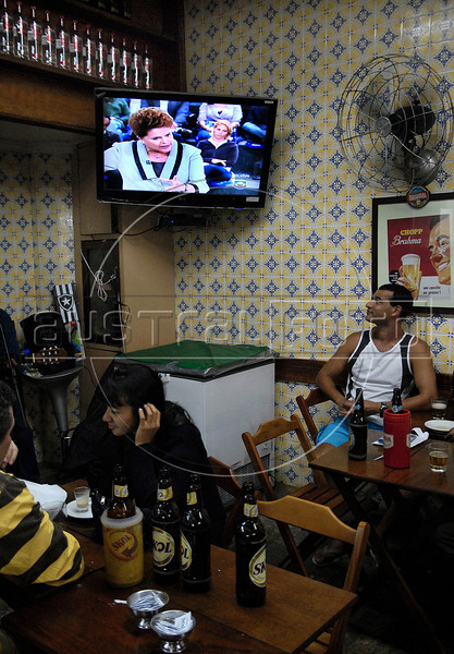 People watch a TV during a live debate between Brazil's presidential candidates Jose Serra of the opposition PSDB party and Dilma Roussef of PT,  Partido dos Trabalhadores, (Workers Party at a bar in Copacabana, Rio de Janeiro, Brazil, October 29, 2010. (Austral Foto/Renzo Gostoli)