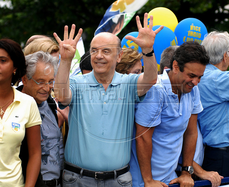 Brazil's presidential candidate Jose Serra, center, of the opposition PSDB party, gestures as he campaigns in Copacabana beach, Rio de Janeiro, Brazil, October 24, 2010. Serra will face Dilma Rousseff of the ruling Workers Party in a presidential runoff Oct. 31. (Austral Foto/Renzo Gostoli)