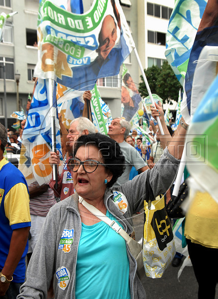 A supporter of Brazil's presidential candidate Jose Serra, of the opposition PSDB party attends a rally in Rio de Janeiro, Brazil, October 24, 2010. Serra will face Dilma Rousseff of the ruling Workers Party in a presidential runoff Oct. 31. (Austral Foto/Renzo Gostoli)