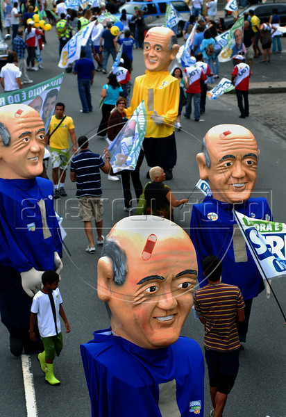 Supporters with big puppets of Jose Serra participate at a rally campaigns of Brazil's presidential candidate Jose Serra, of the opposition PSDB party in Copacabana beach, Rio de Janeiro, Brazil, October 24, 2010. Serra will face Dilma Rousseff of the ruling Workers Party in a presidential runoff Oct. 31. (Austral Foto/Renzo Gostoli)