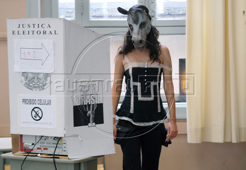 A brazilian citizen, with a donkey masque as protest, votes at a school, Rio de Janeiro, Brazil, October 31, 2010.  (Austral Foto/Renzo Gostoli)