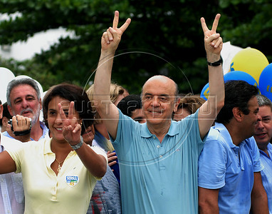 Brazil's presidential candidate Jose Serra, center, of the opposition PSDB party, waves to supporters as he campaigns in Copacabana beach, Rio de Janeiro, Brazil, October 24, 2010. Serra will face Dilma Rousseff of the ruling Workers Party in a presidential runoff Oct. 31. (Austral Foto/Renzo Gostoli)