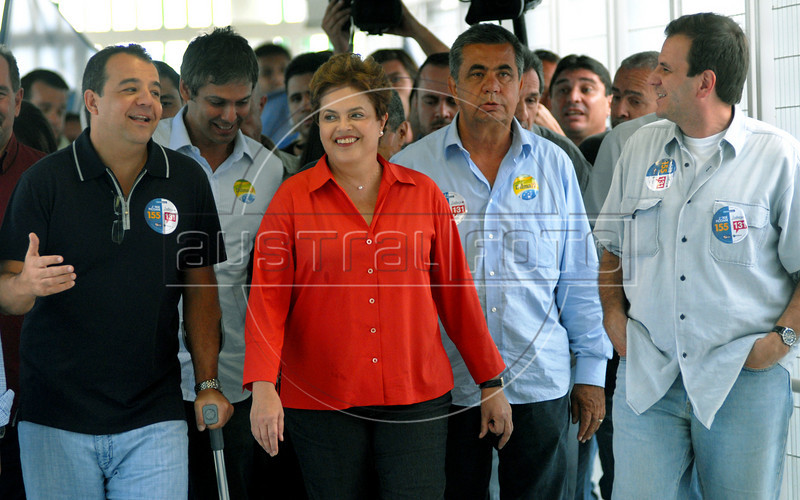 Presidential candidate Dilma Roussef, center,  of PT, Partido dos Trabalhadores, (Workers Party),  Rio de Janeiro's Governor Sergio Cabral, left, and Rio de Janeiro's Mayor Eduardo Paes, right, visit the Cantagalo slum during a campaign rally, Rio de Janeiro, Brazil, September 25, 2010. Brazil will hold presidential elections on October 3. (Austral Foto/Renzo Gostoli)
