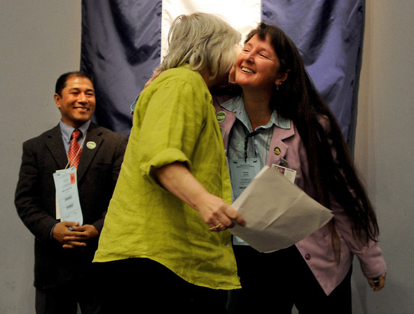 "Sonya Jaquez Lewis, right, hugs  county commissioner candidate, Deb Gardner, after Gardner's speech to the delegates. Suren Shrestha is on the left.<br /> Boulder County Democrats held their 2012 assembly at Skyline High School in Longmont on Saturday.<br /> For a video and more photos  of the assembly, go to  <a href=""http://www.dailycamera.com"">http://www.dailycamera.com</a>.<br /> Cliff Grassmick / March 24, 2012"