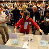 "Delegate, Rebecca Browning, center, joins other delegates voting for county commissioner candidates.<br /> Boulder County Democrats held their 2012 assembly at Skyline High School in Longmont on Saturday.<br /> For a video and more photos  of the assembly, go to  <a href=""http://www.dailycamera.com"">http://www.dailycamera.com</a>.<br /> Cliff Grassmick / March 24, 2012"