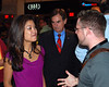 Michelle Malkin speaks with an unidentified man at the VIP reception, Ted Cruz, candidate for U.S. Senate from Texas is in the background.
