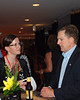 U.S. Senator Jim DeMint speaks with unidentified woman at VIP reception.