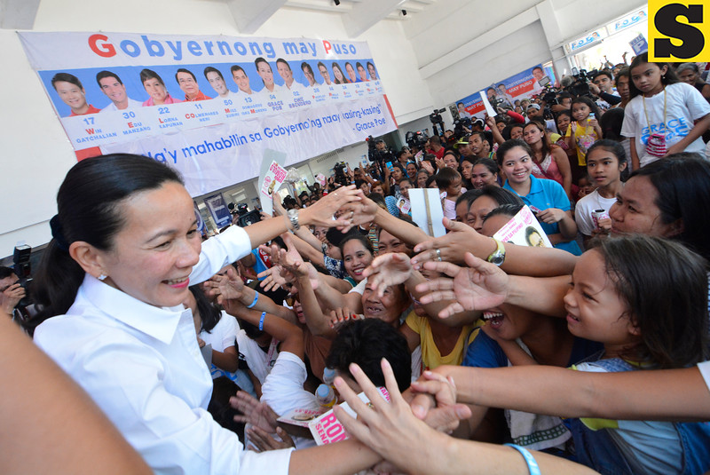 Presidential candidate Grace Poe greets her supporters