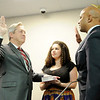Don Knight | The Herald Bulletin<br /> Prosecutor Rodney Cummings is sworn in by Indiana Attorney General Curtis Hill as his daughter Alisha Cummings holds the bible at the Madison County Government Center on Tuesday.