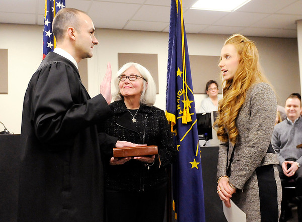Don Knight | The Herald Bulletin<br /> Judge Andrew Hopper is sworn in by his wife Ashley as his mother Durenda holds the bible during a ceremony in Circuit Court 3 on Tuesday.