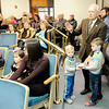 Don Knight | The Herald Bulletin<br /> Green Township Trustee Greg Valentine takes his oath of office with help from his grandsons Micah, left, and William Valentine at the Madison County Government Center on Tuesday.