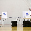 The Douglas family cast their ballot at Highland Middle School on Tuesday.