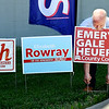 Ben Gale, Republican candidate for County Council, At large, places a campaign sign at the entrance to the Highland Middle School voting site Tuesday.