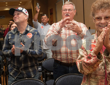 Craig Christman of Tyler, Gerald Lambert of Tyler and Barbara Craig of Henderson applaud as Heidi Cruz takes the stage at the University of Texas at Tyler Ornelas Activity Center Saturday night Feb. 27, 2016. Heidi Cruz campaigned for her husband Republican presidential hopeful Ted Cruz.  (Sarah A. Miller/Tyler Morning Telegraph)