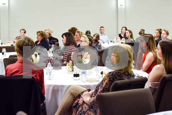 People listen to Texas First Lady Cecilia Abbott, not pictured, speak at the Women Steeping in Politics event in Tyler, Texas, on Thursday, March 15, 2018. The event provided an opportunity for guests to hear about strong women building families and careers and supporting other women. (Chelsea Purgahn/Tyler Morning Telegraph)