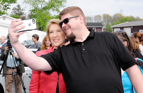Don Knight | The Herald Bulletin<br /> Brian Cohen takes a selfie with Carly Fiorina during her visit with Heidi Cruz to Good's Candy Shop in Anderson on Friday.