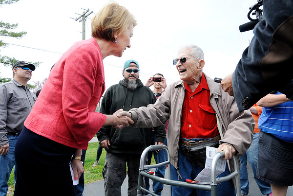 Don Knight   The Herald Bulletin<br /> Carly Fiorina greets WWII veteran Bob Harruff, 98, during her visit with Heidi Cruz to Good's Candy Shop in Anderson on Friday.