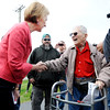 Don Knight | The Herald Bulletin<br /> Carly Fiorina greets WWII veteran Bob Harruff, 98, during her visit with Heidi Cruz to Good's Candy Shop in Anderson on Friday.