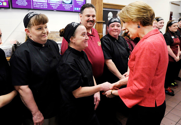 Don Knight   The Herald Bulletin<br /> Carly Fiorina meets the staff at Good's Candy Shop before posing for a photo with them during her visit on Friday.