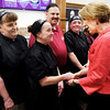 Don Knight | The Herald Bulletin<br /> Carly Fiorina meets the staff at Good's Candy Shop before posing for a photo with them during her visit on Friday.