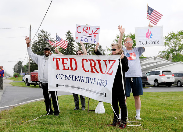 Don Knight   The Herald Bulletin<br /> Ted Cruz supporters stand on 53rd Street in front of Good's Candy Shop during a visit by Carly Fiorina and Heidi Cruz on Friday.