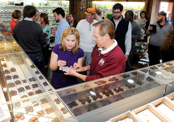 Don Knight | The Herald Bulletin<br /> Good's Candy Shop owner Randy Good gives Heidi Cruz a sample during her visit to Good's Candy Shop in Anderson on Friday.