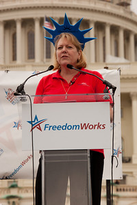 """Virginia """"Ginni"""" Thomas, wife of Supreme Court Justice Clarence Thomas speaks at the 9/12 Tea Party Rally on the West Lawn of the US Capitol in Washington DC on September 12, 2010. Ginni recently founded a new nonprofit lobbying and political-organizing group called Liberty Central meant to appeal to people alligned with """"tea party"""" movements. This has raised concerns in the legal community about about the propriety of a justice's spouse diving headlong into a political movement. (Photo by Jeff Malet)"""