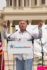 Conservative Internet publisher Andrew Breitbart addresses the crowd at the 9/12 Taxpayer March on Washington on September 12, 2010 on the West Lawn of the U.S. Capitol in Washington D.C.  Brietbart was a featured speaker at the event which was sponsored by FreedomWorks. (Photo by Jeff Malet)