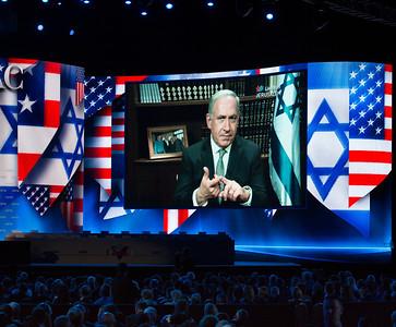 Prime Minister Benjamin Netanyahu speaks via satellite