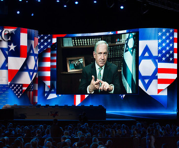 Prime Minister Benjamin Netanyahu speaks via satellite
