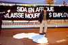 "PARIS - Oct. 16, 2002 - Act Up-Paris( N.G.O. Fighting AIDS), Close Coca-Cola Bottling Plant in Grigny Suburb, as part of international pressure against Coca Cola Corp. to Finance AIDS Treatment for its employees in Africa. Sign Reads"" AIDS in Africa: Coca Cola Lets its Employees Die"""