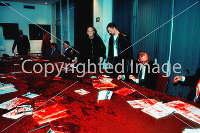 Paris, France - Anti-AIDS Activists of Act Up-Paris Protesting Against Discrimination of HIV Persons by the Insurance Industry, Activists splashing Fake BLood on Conference Table at Comite Suivi Business Meeting, March, 1996.