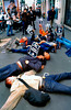 """Paris, France - Anti-AIDS Activists of Act Up-Paris Protesting Against the French Socialist Presidential Candidate, Lionel Jospin, Activists Staging Die-in, Laying DOwn on Pavement in front of Campaign Headquarters Building, 2002. Signs in French Read """"AIDS in Africa: Jospin Racist""""  <form target=""""paypal"""" action=""""https://www.paypal.com/cgi-bin/webscr"""" method=""""post""""> <input type=""""hidden"""" name=""""cmd"""" value=""""_s-xclick""""> <input type=""""hidden"""" name=""""hosted_button_id"""" value=""""6482832""""> <table> <tr><td><input type=""""hidden"""" name=""""on0"""" value=""""Sizes"""">Sizes</td></tr><tr><td><select name=""""os0""""> <option value=""""Website"""">Website €50,00 <option value=""""Medium Size"""">Medium Size €100,00 <option value=""""Hi Definition"""">Hi Definition €200,00 </select> </td></tr> </table> <input type=""""hidden"""" name=""""currency_code"""" value=""""EUR""""> <input type=""""image"""" src=""""https://www.paypal.com/en_US/i/btn/btn_cart_LG.gif"""" border=""""0"""" name=""""submit"""" alt=""""PayPal - The safer, easier way to pay online!""""> <img alt="""""""" border=""""0"""" src=""""https://www.paypal.com/en_US/i/scr/pixel.gif"""" width=""""1"""" height=""""1""""> </form>"""