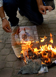 Members of the Rio de Janeiro gay community burn Pope's photos to protest against the Catholic Church's views on homosexuality, abortion and contraceptive methods in Nova Iguacu, 35 miles from Rio de Janeiro, Brazil, May 10, 2007. The Pope is in Brazil for a five-day visit. (Austral Foto/Renzo Gostoli)