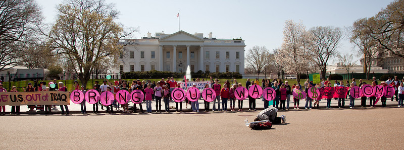 "Code Pink says it with pink umbrellas - ""Bring Our War $$ Home"""