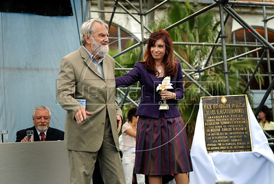 "Argentinian historian and writer Osvaldo Bayer, left, author of ""The Rebellious Patagonia"" (""La Patagonia rebelde""), (the avengers of the tragic Patagonia), receives from Argentina's president Cristina Kirchner, right, the award ""Azucena Villaflor"" for his actuation defending human rights and the ""desaparecidos"" citizens missing during the dirty war of 1970s in the ESMA, Escuela de Mecanica de la Armada, a argentinian navy military center where more 5000 disappear, Buenos Aires, Argentina, December 18, 2008. (Austral Foto/Renzo Gostoli)"