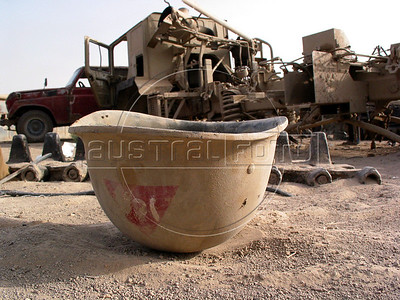 An Iraqi army helmet is one of many reminders of   Iraq's history of wars with Iran, Kuwait and the United States, at a junk yard of scrap military hardware, south of Baghdad.(Australfoto/Douglas Engle)